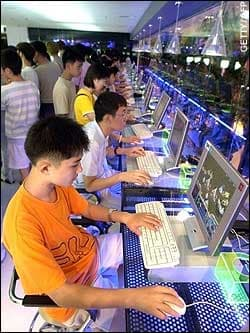 internet addiction: photo of multiple children and young people using computers