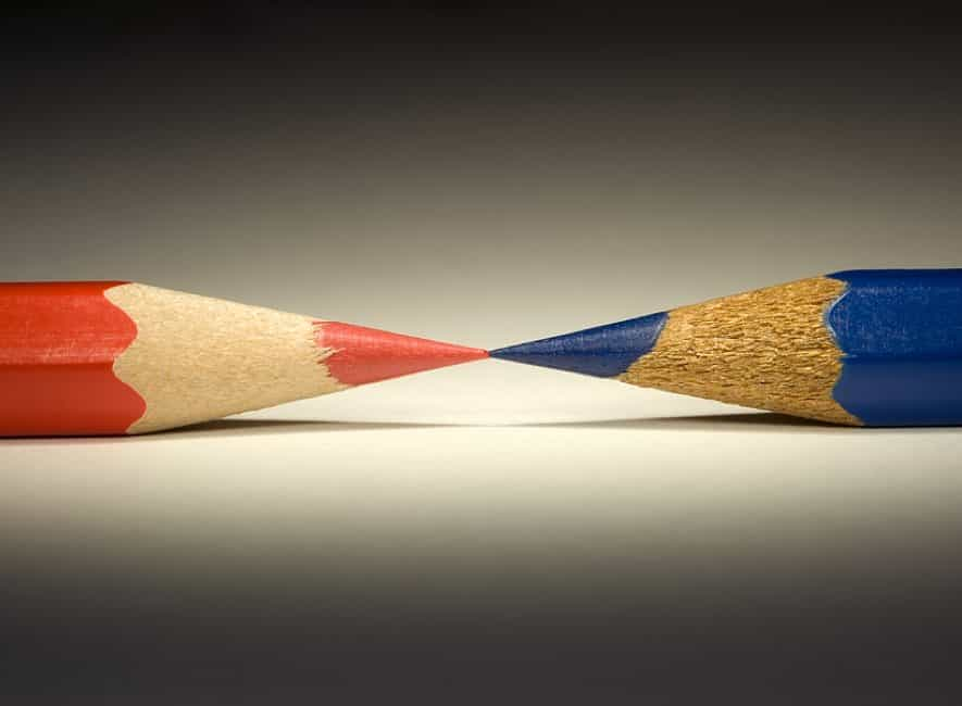 Photo of red and blue pencil points lined up exactly point-to-point
