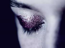 Close-up photo of woman's eye with glittered eyeshadow