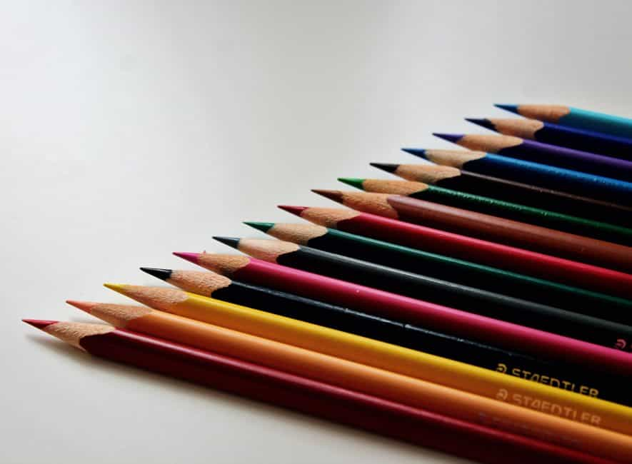 Colored crayons arranged and lined up precisely