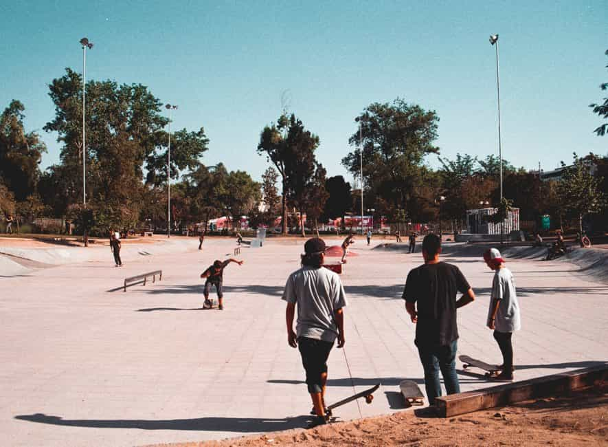 Teens at skateboard park
