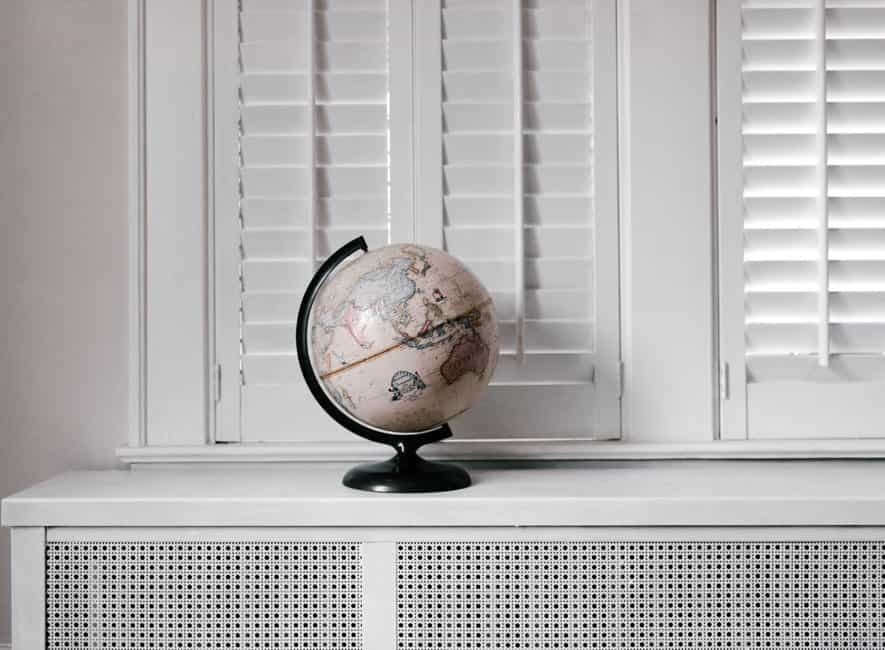 Beige desk globe on white desk