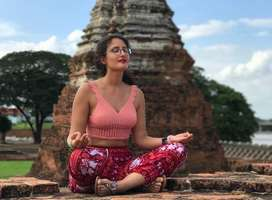 Woman sitting in meditation pose at Tambon Ban Pom, Thailand