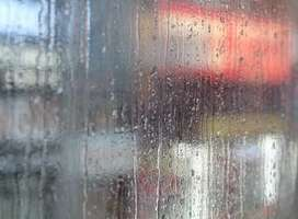Raindrops running down frosted glass