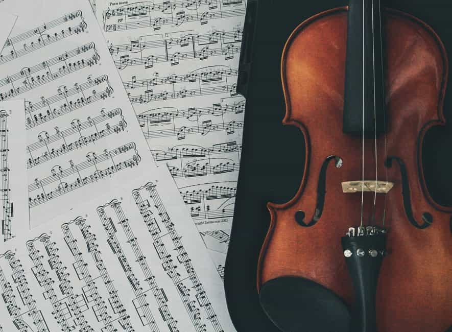 Violin and multiple pages of printed music