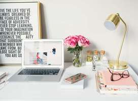 Blogger desk, notebook computer, with motivational picture text