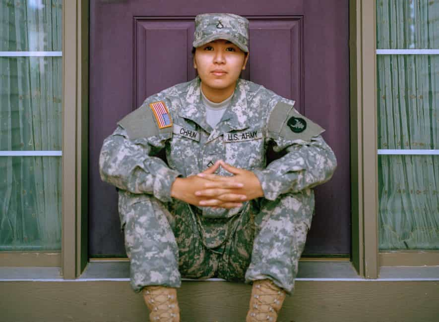 US soldier sitting on steps patiently waiting