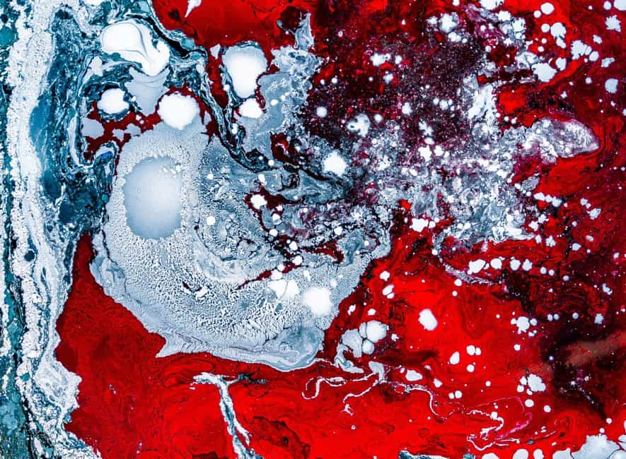 Abstract painting made up of alien cold blue and red swirls