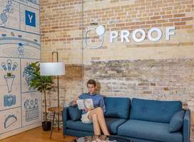 Client sitting on sofa under Proof sign