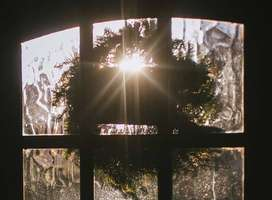 Photo of low dim winter sun shining through doorway panes of glass