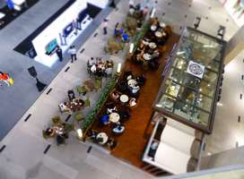Aerial view of people eating inside building during daytime