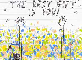 Mural on outside wall with the words the best gift is you