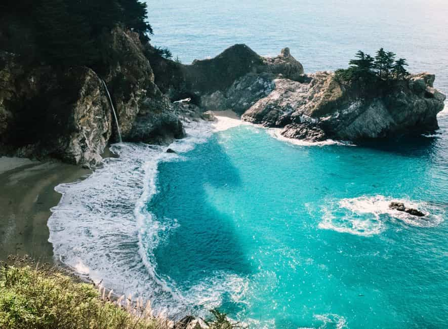 Photo of beautiful beach, shoreline, and azure-colored sea on sunny day