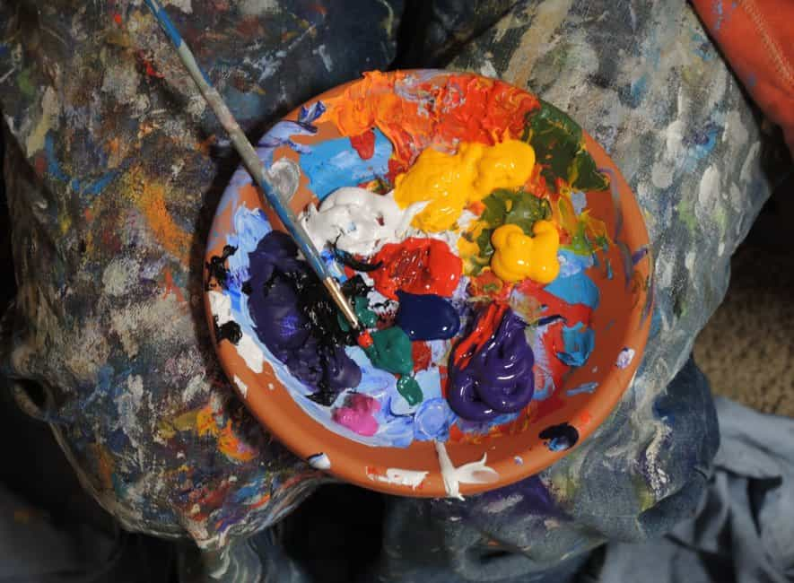 Mixing and blending colored artist paints on a plate