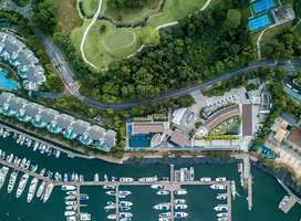 Aerial photo of marina and plush homes