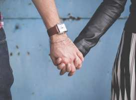 Close up of couple holding hands, no faces visible