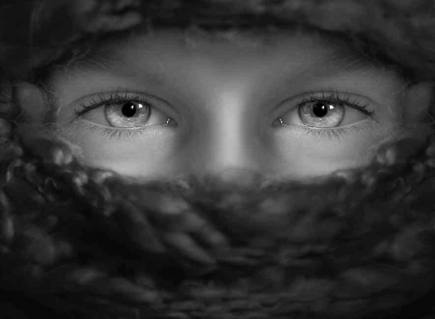 Greyscale photo of human eyes, face obscurred