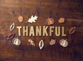 The word Thankful on wood background