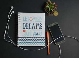 Let your dreams set sail quote on book cover with smartphone