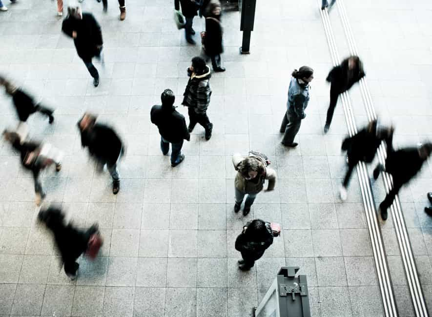 Distance photo of people walking around a public building