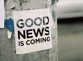 Good News is coming message stuck to lampost