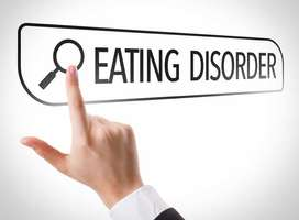 Finger pointing at eating disorder button on screen.