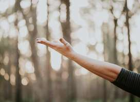 Woman's hand outstretched and upturned in positive motion