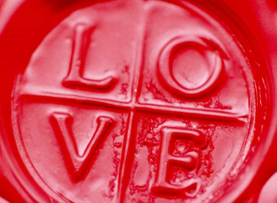 The word love embossed into red substance