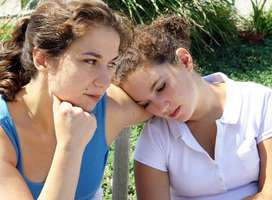 Image illustrating family problems: older female consoling younger female