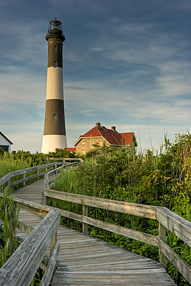 Lighthouse with meandering wooden access pathway
