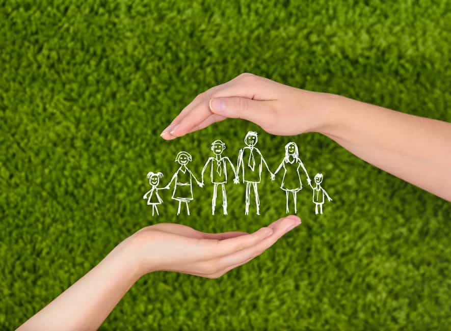 Image of woman's hands protecting illustration of family