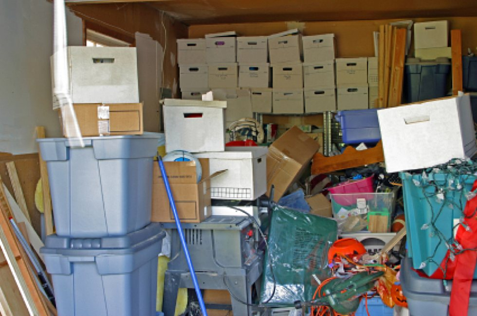 Collection of hoarded boxes and items piled up in room.