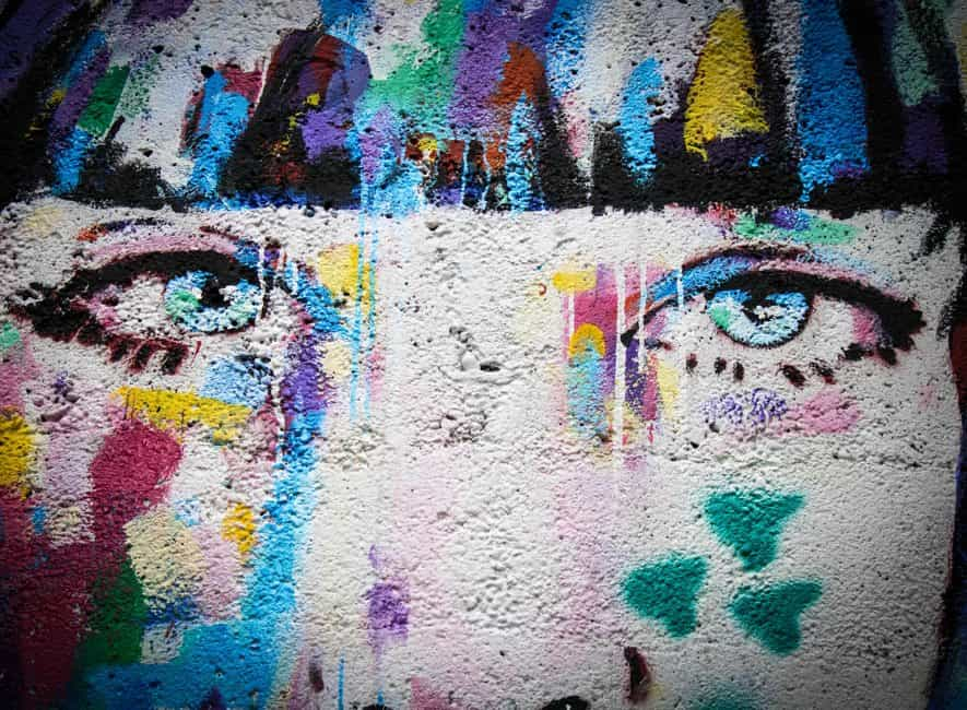 Artwork on an outside wall of a person's face